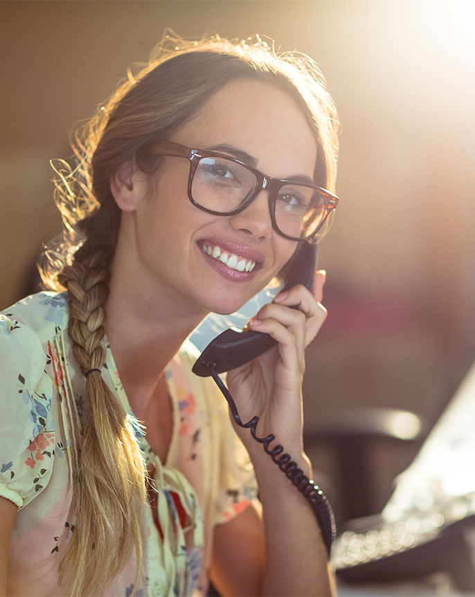 smiling-woman-talking-on-phone-in-office